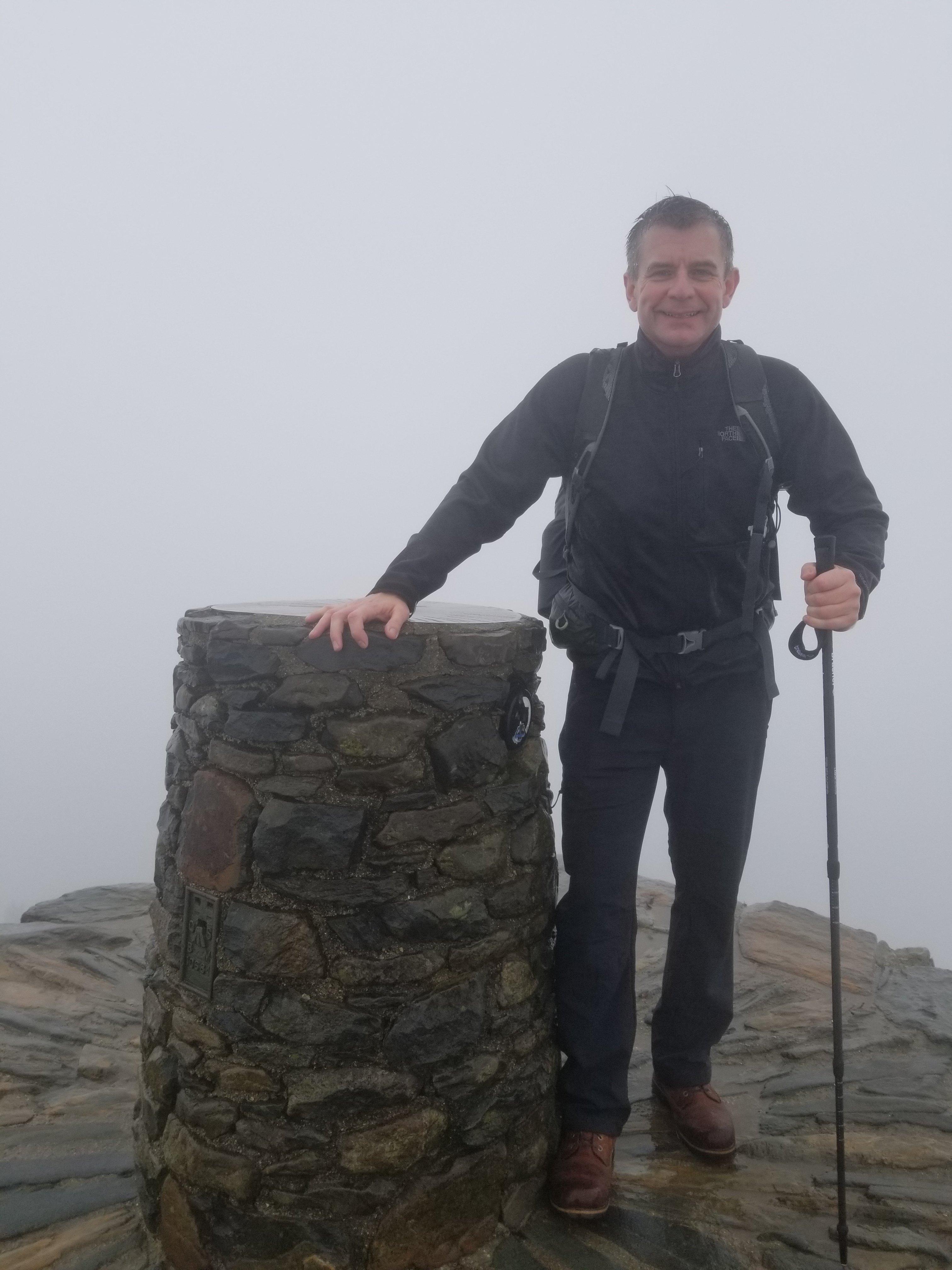 Nigel Yates on the summit of Mount Snowdon